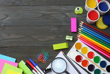 school and office supplies. school background. colored pencils, pen, pains, paper for  school and student education on dark wooden background. top view with copy space - 164096473
