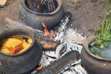 Clay pots for cooking natural wool on the bonfire - 164099617