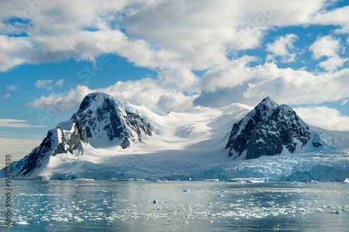 Fotobehang Antarctica Glacier carved snow capped mountains in Antarctica.