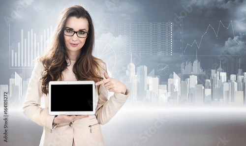 Business style photo of a woman holding a tablet