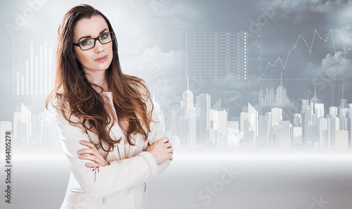 Businesswoman posing on a graph background