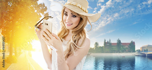 Portrait of a pretty blonde using a smartphone