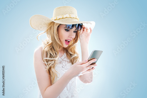 Portrait of an elegant young lady using a smartphone