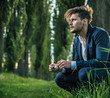 Young, calm man enjoying the summer time - 164105895