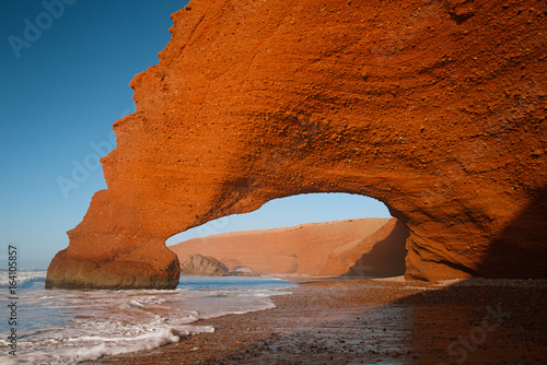 Fotobehang Rood traf. Legzira stone arches, Atlantic Ocean, Morocco, Africa