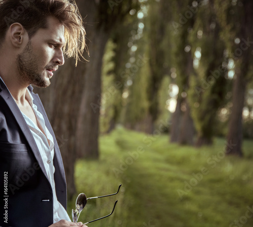 Foto op Plexiglas Artist KB Profile portrait of a tired man relaxing in the countryside