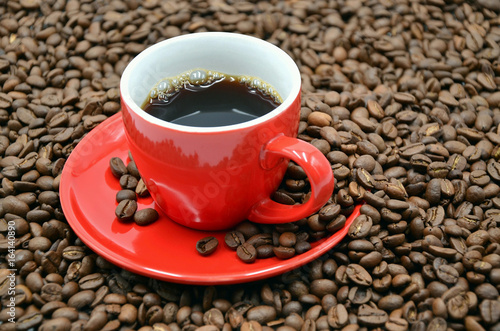 coffee cup with many coffee beans photo