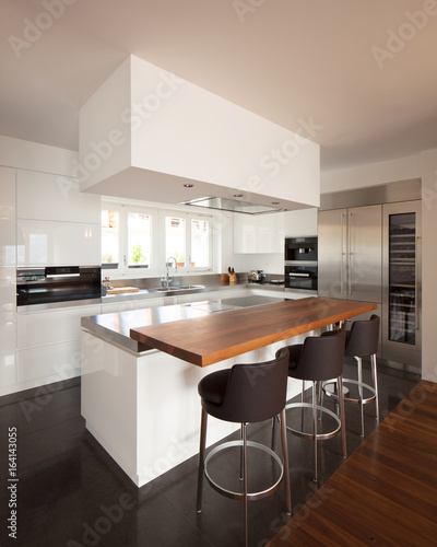 Modern kitchen in luxury apartment. - 164143055