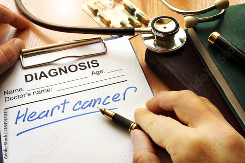 Heart cancer diagnosis on a medical form.