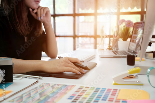 Graphic designer woman working on creative office with create graphic on computer Poster