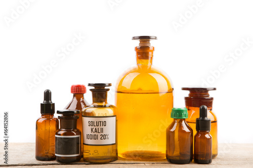 Different vintage pharmacy bottles isolated on white