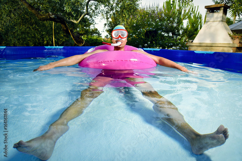 man swimming in a portable swimming pool