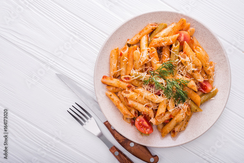 delicious penne pasta on wood white table