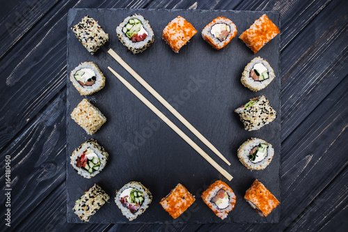 Japanese sushi on a rustic dark background