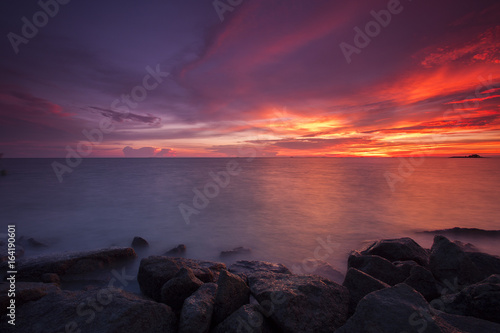 Tuinposter Aubergine scenery of sunset at Tanjung Piandang,Malaysia. Soft focus,motion blur due o long exposure.