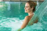 Fototapety Beautiful attractive woman enjoying time in pool