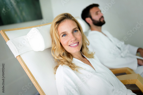 Beautiful woman with handsome man relaxing in spa