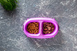 Cat feed in bowl and grass on grey stone background top view copyspace - 164199059