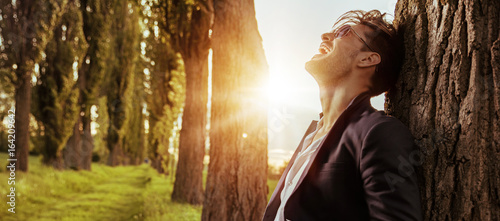 Handsome businessman enjoying the summer journey