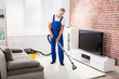 Male Janitor Vacuuming Carpet - 164225822