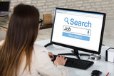 Businesswoman Searching Online Job In Office - 164230097