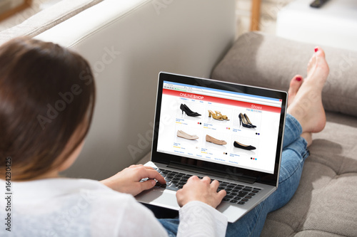 Woman Doing Online Shopping - 164230425