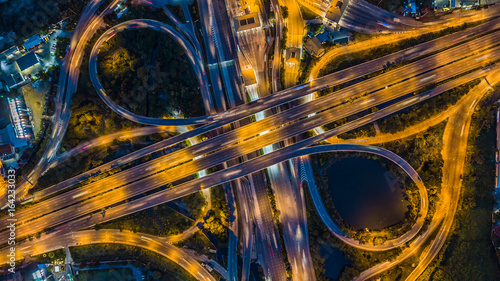 Bangkok Expressway top view, Top view over the highway, expressway and motorway at night, Aerial view interchange of a city, Shot from drone, Expressway is an important infrastructure in Thailand - 164233033