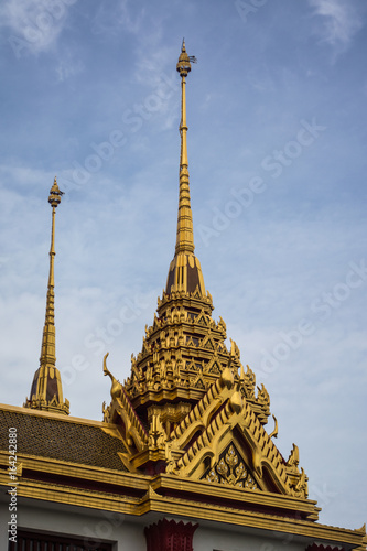 Loha Prasat Wat Ratchanatdaram in Bangkok Thailand which means iron castle or monastery is composes of five towers, of which the outer, middle and the center tower contain large black iron spires.