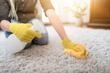 Housewife cleaning carpet. - 164247237