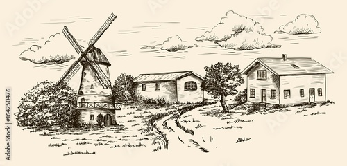 windmill, village houses and farmland
