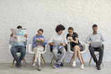 People using digital devices - 164259835
