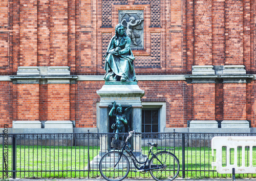 Black bicycle on the background of a historic building and monument, typical cityscape, Copenhagen