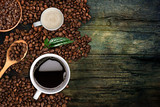 Coffee background, top view with copy space. White cup of coffee and milk, ground coffee, coffee beans on dark wooden background - 164275480