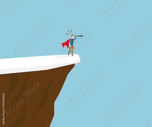 businessman with telescope standing at cliff