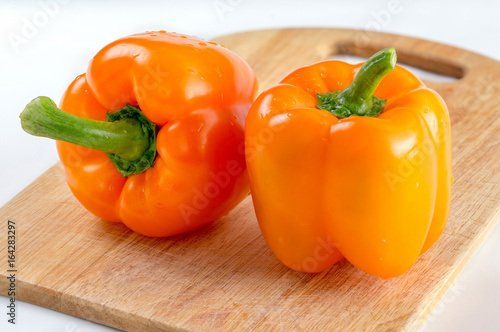 orange peppers on the Board isolated background - 164283297
