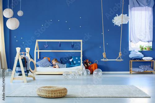 Girl reading in bedroom - 164285486