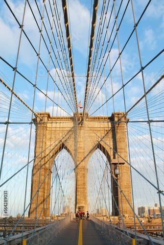 Portrait image of the famous Brooklyn bridge in warm sunlight Poster