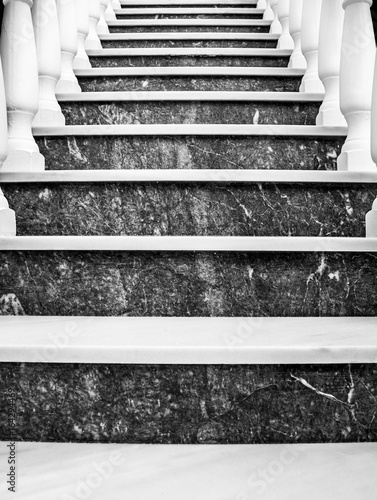 Black and white, marble stairs with banisters