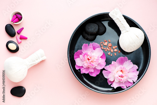 Spa with herbal massage balls and beautiful flowers i