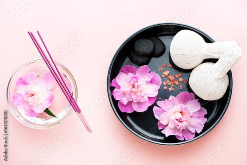 Spa. Herbal massage balls, flowers, black stones, incense and sea salt
