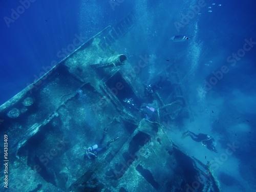 Divers exploring a wreck, Pomonte, Elba island, Italy