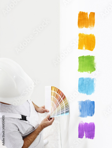 painter man with color swatches in your hand, Choice of colors concept, and color samples on white blank background