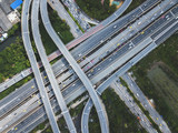 Aerial view from the drone on the highway of freeway and downtown with massive intersection, stack interchange, elevated road junction