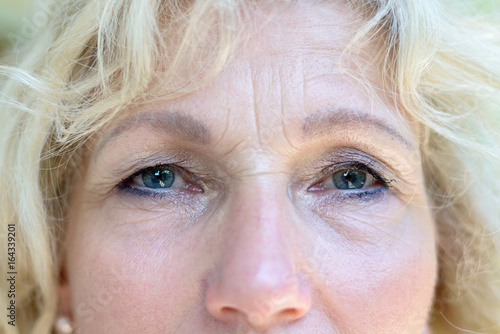 Cropped face portrait of attractive senior woman Poster