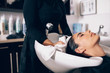Woman at hair dressing salon getting hair treatment - 164347275