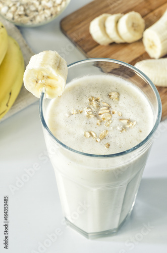 Foto op Aluminium Milkshake Milkshake with banana and oatmeal , healthy breakfast