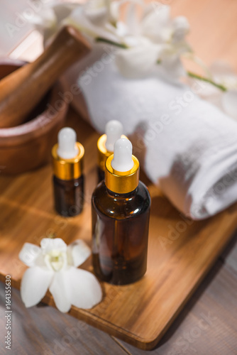 Spa still life with towel, white orchid, bath oil