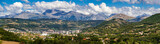 The city of Gap in the Hautes Alpes with surrounding mountains and peaks in Summer. Panoramic. Southern French Alps, France - 164360486