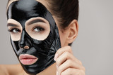 Woman Face Mask. Closeup Beautiful Girl Removing Black Mask - 164363825
