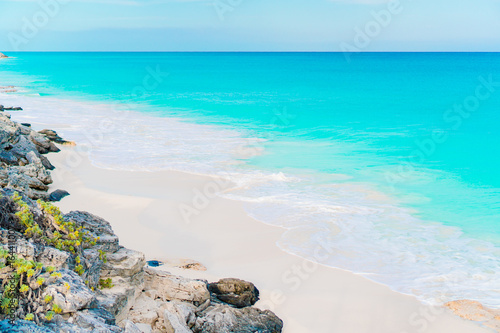 Perfect white sandy beach with turquoise water and blue sky. Amazing picture